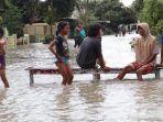 banjir-akibat-luapan-sungai-watudakon-jombang.jpg