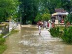 banjir-luapan-kali-lamong-kembali-menggenangi-pemukiman-dan-lahan-pertanian-warga.jpg
