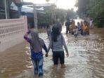 banjir-yang-merendam-sejumlah-desa-di-kecamatan-mojoagungjombang-sutono_20170225_114507.jpg