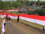 bendera-sepanjang-1218-meter-di-atas-tanggul-lumpur-lapindo_20180623_202946.jpg