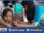 berita-ilustrasi-siswa-sd-surabaya-menjalani-imunisasi-tetanus-di-uks-sekolah_20160225_221545.jpg