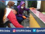 berita-surabaya-tri-rismaharini_20160910_132022.jpg