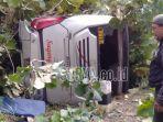 bus-sugeng-rahayu-terbalik-di-jalan-raya-ngawi-mantingan-km-20-21.jpg