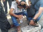 darwin-wartawan-di-makassar-yang-menjadi-korban-pemukulan-saat-bentrokan-polisi-dan-mahasiswa.jpg