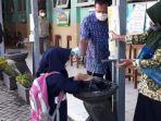 di-depan-ruang-kelas-disiapkan-tempat-cuci-tangan-sesuai-protokol-kesehatan.jpg