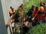 foto-ilustrasi-petugas-mengevakuasi-jenazah-korban-tenggelam.jpg