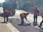 ilustrasi-perbaikan-jalan-di-kawasan-desa-pandanrejo-kota-batu.jpg