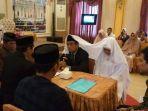 istri-pertama-izinkan-menikah-lagi-berikut-4-fakta-pns-di-makassar-poligami-viral-di-whatsapp-wa.jpg