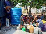 jajaran-polres-nganjuk-menyalurkan-bantuan-air-bersih-di-desa-gampeng-kecamatan-ngluyu.jpg