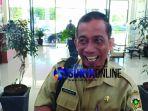 kepala-dinas-lh-kabupaten-madiun-bambang-brasianto-usai-diperiksa_20180507_141732.jpg