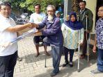 koordinator-relawan-khofifah-emil-wilayah-sidoarjo-haji-masnuh_20180223_223803.jpg
