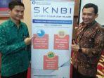 nasrullah-kiri-asisten-direktur-kantor-perwakilan-bank-indonesia-kediri.jpg