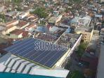panel-solar-cell-yang-terpasang-di-atap-bangunan-ponpes-wali-barokah.jpg