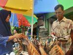 pedagang-ikan-asap-di-jalan-panglima-sudirman-kelurahan-karangsari-melayani-deui.jpg