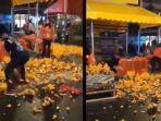 pedagang-jeruk-ngamuk-banting-jeruk-ke-jalan-karena-tak-laku-kominfo-ungkap-fakta-sebenarnya.jpg