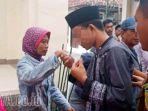 pelajar-pembunuh-guru-budi-di-sampang-divonis-6-tahun-penjara_20180306_194949.jpg