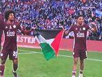 pemain-leicester-city-bentangkan-bendera-palestina.jpg