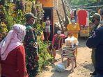 pendistribusian-bantuan-sembako-bagi-warga-isolasi-mandiri-di-kota-kediri.jpg