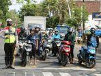 pengguna-jalan-di-malang-nyanyikan-lagu-indonesia-raya.jpg