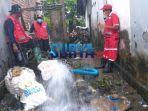 pengurasan-air-setelah-banjir-di-jember.jpg
