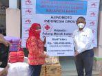 penyerahan-bantuan-ajinomoto-indonesia-kepada-korban-bencana-di-kalsel-dan-sulbar.jpg