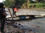 perempuan-hanyut-di-sungai-brantas-tulungagung_20180823_205427.jpg