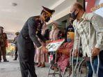 polres-tulungagung-bagi-sim-gratis-untuk-penyandang-disabilitas-di-hut-bhayangkara-ke-75.jpg