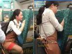 pramugari-cantik-terekam-sedang-menghibur-penumpang-kereta-yang-menangis-videonya-viral-di-facebook.jpg