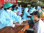 proses-peserta-vaksinasi-massal-di-yon-arhanud.jpg