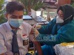proses-vaksinasi-covid-19-pelajar-di-kota-surabaya.jpg