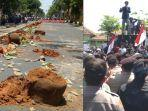 puluhan-pot-bunga-di-pulau-jalan-di-jl-kabupaten-pamekasan-dihancurkan-massa.jpg