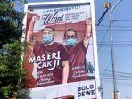 reklame-bertuliskan-arek-suroboyo-wani-bersama-erji-eri-cahyadi-armuji.jpg