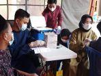 relawan-bantu-vaksinasi-covid-19-di-banyuwangi.jpg