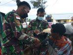 satgas-pamrahwan-yonif-rk-751vjs-juga-gelar-pengobatan-gratis.jpg