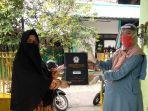 sd-muhammadiyah-14-surabaya-bagikan-rapor-secara-delivery-ditengah-pandemi-virus-corona.jpg
