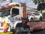 truk-trailer-mengangkut-hadiah-mobil-tabungan-simpedes-bri.jpg