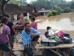warga-di-kabupaten-madiun-mengungsi-karena-banjir-rabu-632019.jpg