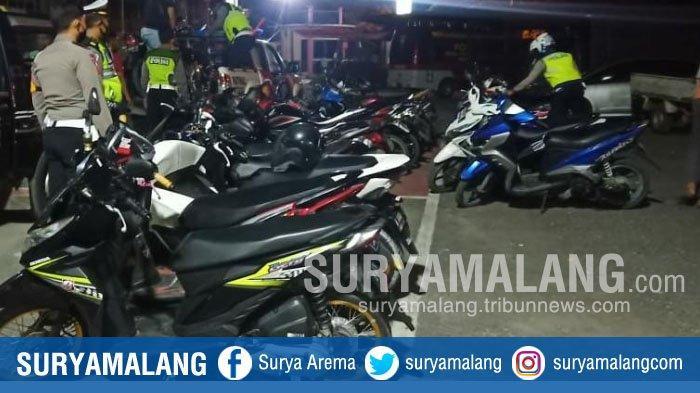 Bubarkan Balapan Liar di Jalan Raya Bancaran, Polres Bangkalan Sita 28 Motor