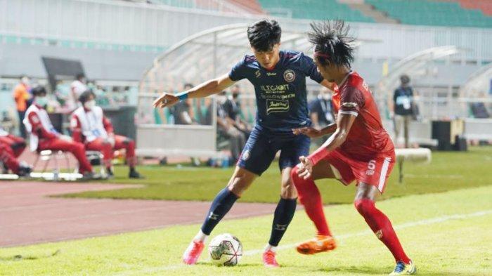 Pemain Arema FC, Feby Eka di laga Arema FC Vs PSM Makassar, 5 September 2021.