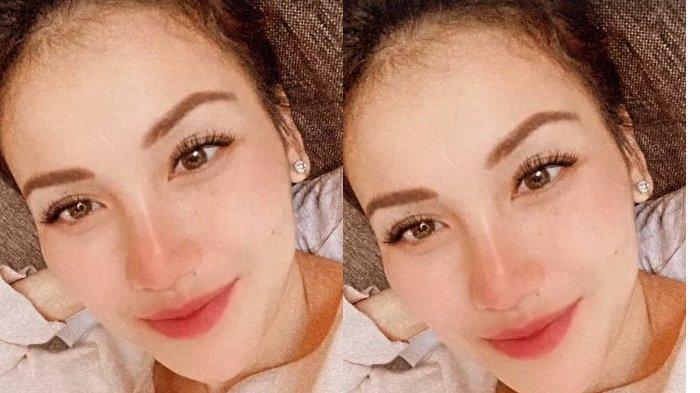Foto wajah cerah Ayu Ting Ting saat liburan (Instagram @ayutingting92).