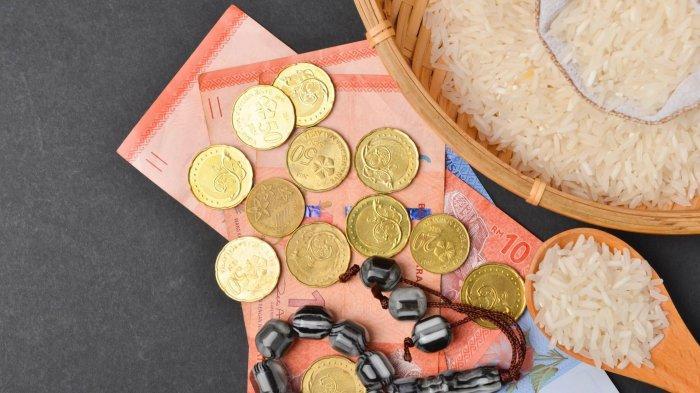 ILUSTRASI - Zakat fitrah dalam artikel waktu membayar dan bacaan niatnya