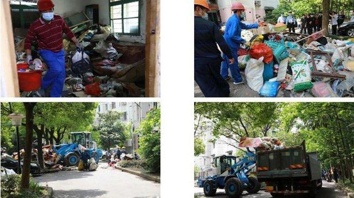 Para petugas membersihkan rumah Dong dengan bantuan 15 truk