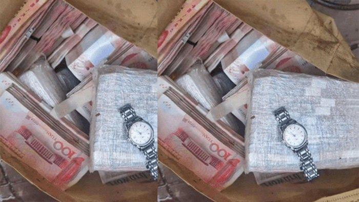 Setumpuk uang dan jam tangan mahal di dalam koper yang ditemukan mengambang di sungai