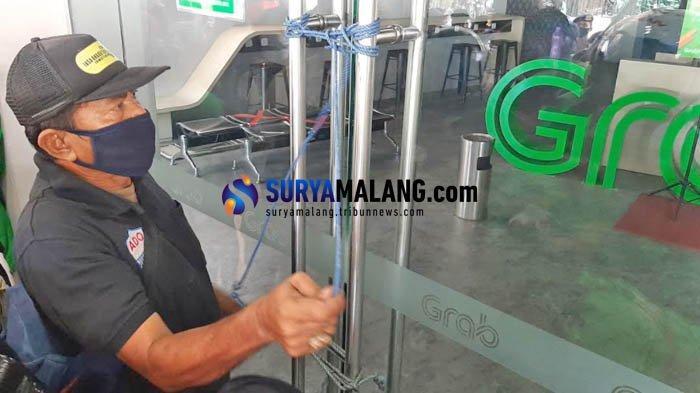 Kantor Kosong, Massa Driver Ojek Online se-Jatim Segel dan Duduki Kantor Grab di Surabaya