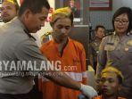 ahmad-bima-armadani-18-dan-erik-lukman-21-setelah-ditangkap-anggota-polresta-malang-kota.jpg