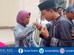 ahmad-budi-cahyanto-guru-seni-budaya-sman-1-torjun-sampang_20180307_001235.jpg