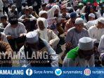 aksi-solidaritas-umat-muslim-rohingya-myanmar-di-jalan-tugu-kota-malang-jumat-892017_20170908_142648.jpg