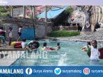 anak-anak-berenang-di-de-berran-yang-berada-di-desa-oro-oro-ombo-kota-batu_20170820_194602.jpg