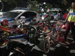 anggota-satlantas-polres-madiun-menyita-puluhan-kendaraan-berknalpot-brong.jpg