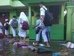 banjir-masih-menggenangi-kompleks-smpn-2-tanggulangin-sidoarjo.jpg